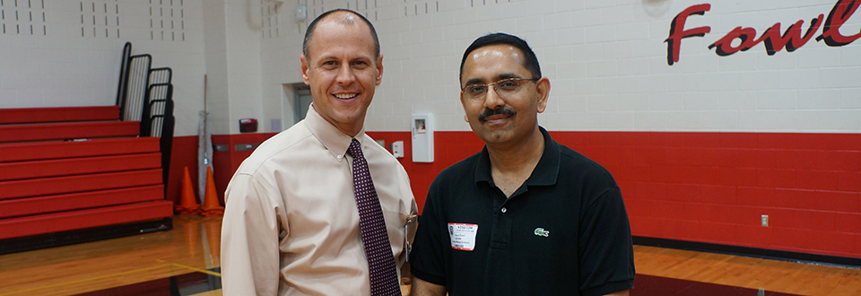 Sood with Fowler Principal Donnie Wiseman